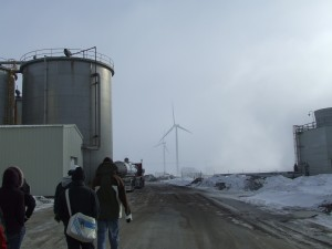 This ethanol plant, Corn Plus, meets some of its electricity needs via two wind turbines next to the plant.