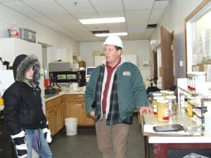 Our tour guide shows us the plant's lab.