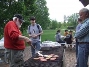 Professor Bob Douglas grills 'em and serves 'em.