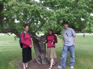 Geocache! These students used GPS to find a stash of candy hidden in this tree.