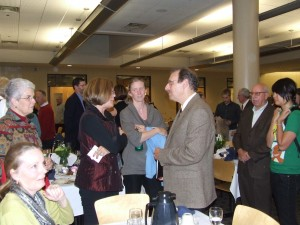 Audience members line up to talk to Dr. Graf after his lecture at the Nobel Conference Banquet.