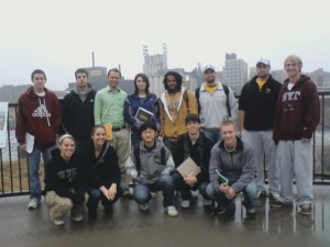 Geography students in front of St Anthony Falls on the Mississippi River.
