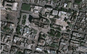 The same part of Port-au-Prince after the January 12, 2010, earthquake, which destroyed the Cathedral, among many other structures. The archbishop of Port-au-Prince is among the many who have died in the disaster. (Image from Google Earth.)