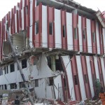 A hotel in Port-au-Prince. One floor was completely flattened between the other floors. Structures that were destroyed tend to have collapsed walls rather than collapsed roofs.