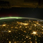 Astronaut photograph of the Midwest at night showing city lights, the aurora borealis, and a storm in the east. Aquired Sept. 29, 2011 by NASA's Earth Observatory. (See http://earthobservatory.nasa.gov/IOTD/view.php?id=76201 for more information.)
