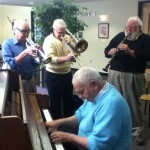 Prof. Bob Douglas and band, the Floodplain Four, play Dixieland in the Campus Center on Tuesday.