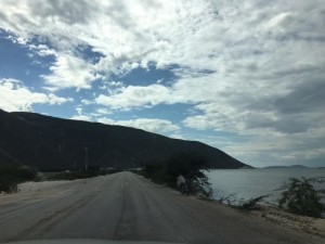 A view of the Haiti-Dominican Republic at the Malpasse/Jimani road crossing. Étang Saumâtre, the lake on the Haitian side, continues to rise. The road to cross the border has been raised to the point it is a causeway. (Photo by Anna Versluis.)